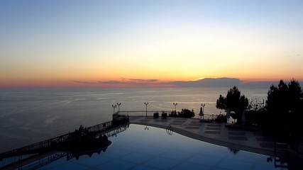 Sea and swimming pool at sunset