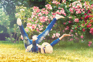 Happy funny child having fun on the grass. Messing around.