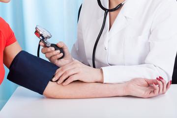 Doctor doing professional pressure examine