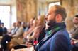 Leinwandbild Motiv Entrepreneur in audience at business conference.