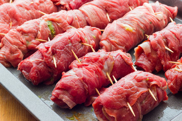 beef rolls stuffed with bacon ready to be cooked