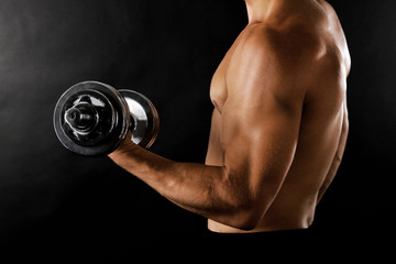 Athletic man execute exercise with dumbbells,