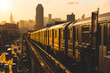 canvas print picture - Subway Train in New York at Sunset