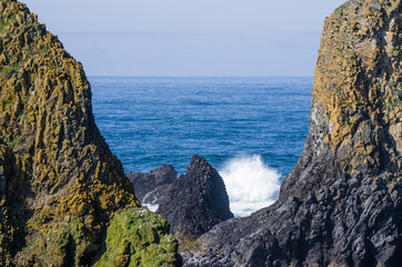 Towering rock formations with surf
