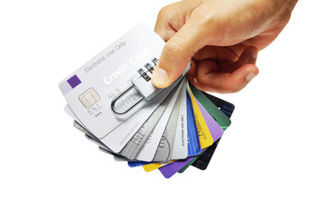 hand holding credit cards with security lock