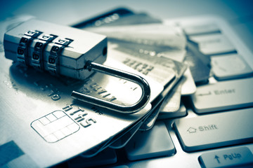 open security lock on credit cards with computer keyboard