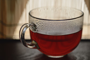 A cup with black tea