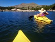 Woman kayaking on a beautiful Mountain Lake.