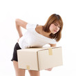 unhappy woman carrying heavy box with pain