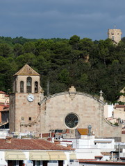 The Parish Church of Sant Vicent and a fortress tower in Tossa d