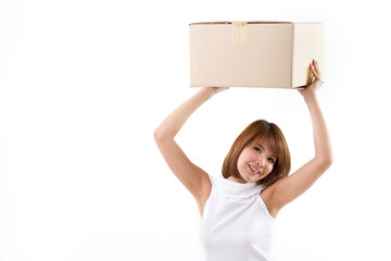 happy, smiling woman carrying carton box for moving concept