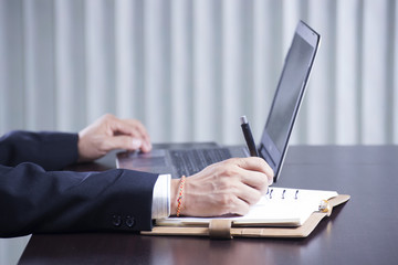 hands writing at business document