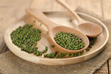 Mungbeans with wooden plate and wooden spoon