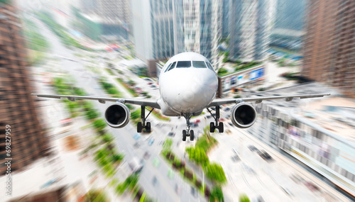 Fototapeta the airplane away from the city