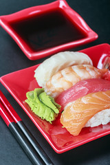 seafood sushi and chopstick on a red plate