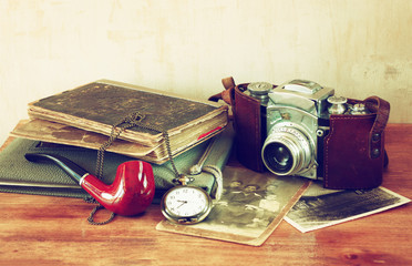 old camera, antique photographs and old pocket clock