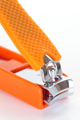 Orange nail clipper isolated on a white background