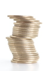Silver coins stack on a white background
