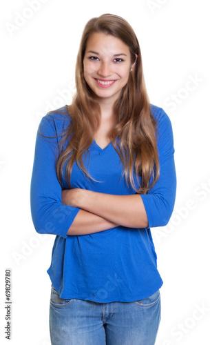 canvas print picture Blonde Frau mit blauem Shirt und verschränkten Armen