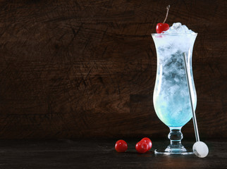Elegant blue curacao cocktail with ice