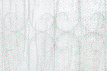 Translucent old curtain with curved steel.