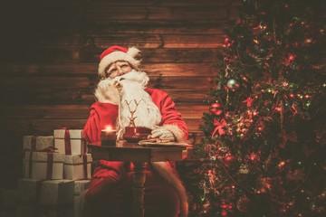 Santa Claus in wooden home interior