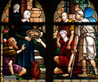 Feeding the poor in stained glass