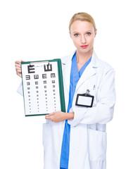 Optician doctor with eye chart