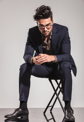business man sitting on chair and looking down