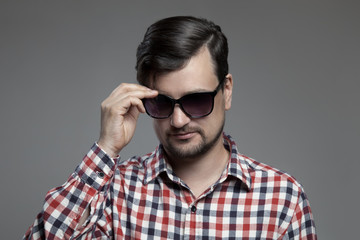 Handsome hipster modern man in sunglasses.