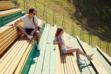 Modern urban young couple in the park, youth, love, dating