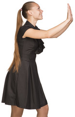Isolated young casual woman push imaginary wall