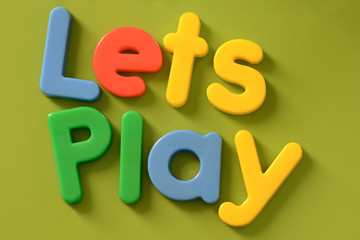 Close up of Lets Play words in colorful plastic lettersd