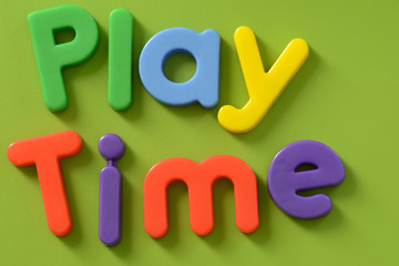 Close up of Play Time words in colorful plastic letters