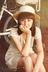 Young woman with retro bicycle in a park. Lightleak effect and i
