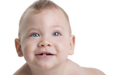 Neonato sorridente con occhi azzurri