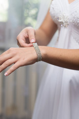 bride wears a decoration on hand