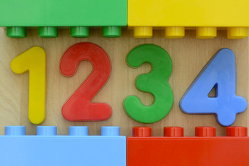 Close up of colorful 1 2 3 4 in plastic toy numbers