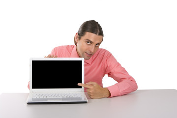young man with laptop pointing at the monitor over white backgro