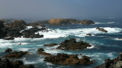 Waves Crashing on Rocks, calm weather