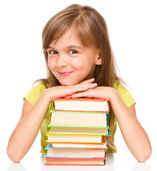 Little girl with her books