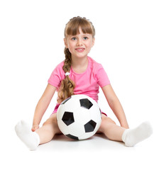 Little girl sitting with soccer ball isolated on white