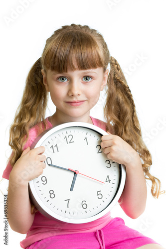 canvas print picture Girl displaying seven o'clock time in studio isolated