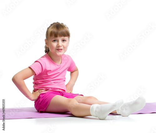 canvas print picture Girl doing gymnastic exercises isolated  on white