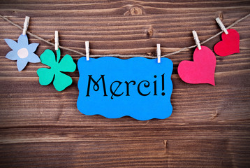Blue Merci Banner with different Symblos on a Line