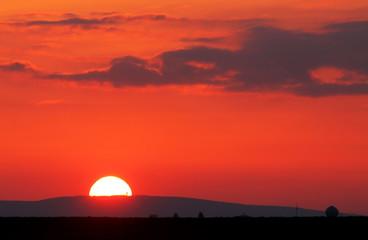 Red sunrise over horizont
