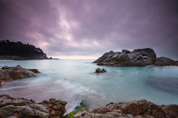 Sunrise at Cala Boadella, Lloret beach in Costa Brava. Catalonia