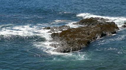 Waves Crashing on Rocks, calm weather