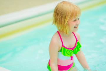 Portrait of happy baby girl in swimming pool