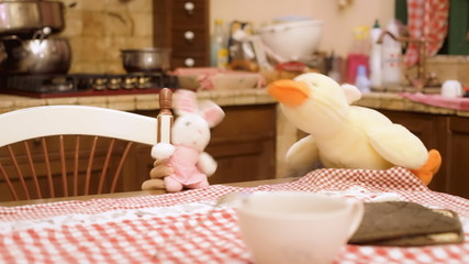 Stuffed toys bunny duck in kitchen